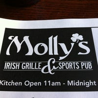 Photo taken at Molly's Irish Grille and Sports Pub by Dan W. on 3/14/2012