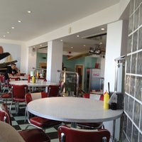 Photo taken at Woodies Longboard Diner by Tristan B. on 8/22/2012