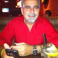 Photo taken at The Garage Restaurant & Bar by MoniQue on 3/1/2012