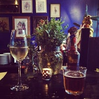 Photo taken at Mignon Wine & Cheese Bar by dana r. on 9/1/2012