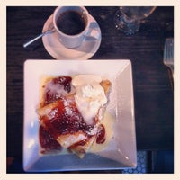 Photo taken at Aviary Cafe & Creperie by Jonathan on 8/26/2012