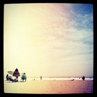 Photo taken at La Pobla de Farnals Beach by Mario T. on 5/19/2012