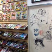 Photo taken at Earth2Comics by Mole M. on 8/16/2012