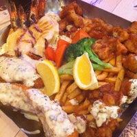 Photo taken at The Manhattan Fish Market by Ben S. on 3/15/2012