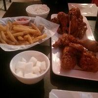 Photo taken at Bonchon Chicken by Wein K. on 8/11/2012