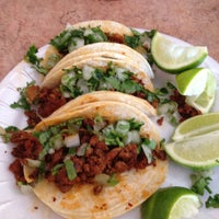 Photo taken at Lilly's Taqueria by Ryan R. on 4/4/2012