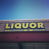 Photo taken at Liquor and Tobacco by Eryn T. on 7/21/2012