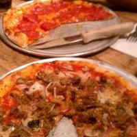 Photo taken at Bartolotta's Pizzeria Piccola by Erin S. on 1/22/2012