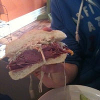Photo taken at Mudgie's Deli by Angie L. on 3/5/2011