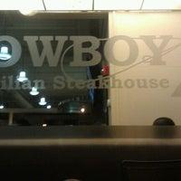Photo taken at Cowboy Brazilian Steakhouse by Ashley B. on 8/28/2011
