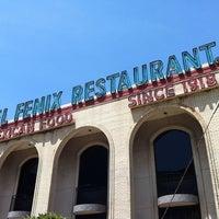 Photo taken at El Fenix Restaurant by Debra R. on 8/3/2012
