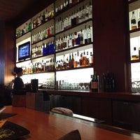 Photo taken at The Corner Office Restaurant & Martini Bar by Grace B. on 3/5/2012