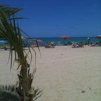 Photo taken at Isla Verde Beach - Balneario Isla Verde (La Playa) by sophia s. on 4/8/2012