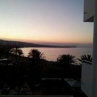 Photo taken at Okeanos Beach Hotel by Katerina M. on 8/28/2012