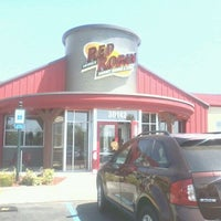 Photo taken at Red Robin Gourmet Burgers by Joanie M. on 8/18/2012
