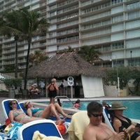 Photo taken at Bamboo Beach Tiki Bar & Cafe by Jason S. on 5/18/2012