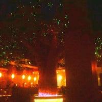 Photo taken at Koko Sushi Bar & Lounge by Roxanne H. on 3/6/2012