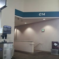 Photo taken at Concourse C by Jamie T. on 8/21/2012
