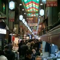 Photo taken at Nishiki Market by chika d. on 1/14/2012