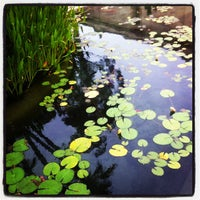 Photo taken at Botanical Building & Lily Pond by Yuri F. on 5/18/2012
