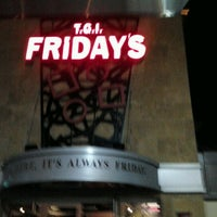 Photo taken at TGI Fridays by Herbie H. on 12/7/2011