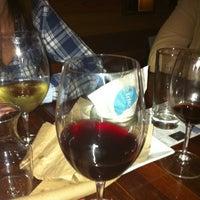 Photo taken at Pourtal Wine Tasting Bar by Simona C. on 11/16/2011
