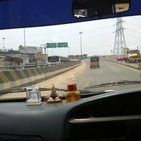 Photo taken at koyambedu signal by Ilavarasi E. on 3/31/2012