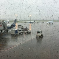 Photo taken at Gate C27 by Christopher W. on 7/16/2012