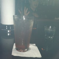 Photo taken at SLIDERS Sports Lounge by Chris B. on 8/22/2012