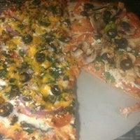 Снимок сделан в Naked Pizza пользователем Gavin B. 10/27/2011