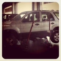 Photo taken at Discount Tire® Store by Hillarie on 5/20/2011