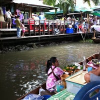 Photo taken at Taling Chan Floating Market by Nueng on 6/19/2011