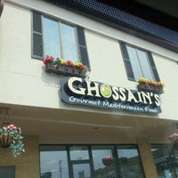 Photo taken at Ghossains Gourmet Mediterranean Foods by Kelly H. on 9/2/2011