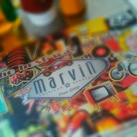Photo taken at Marvin American Burgers by Flávia M. on 12/26/2011