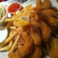 Photo taken at Bubba Gump Shrimp Co by Valentino L. on 3/9/2012