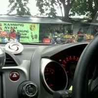 Photo taken at Sate Barokah Pucang by Wira W. on 1/29/2012