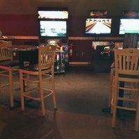 Photo taken at Huberts Sports Bar & Grill by Joel J. on 8/6/2011