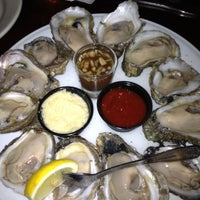 Photo taken at Crescent City Grill by Twirly J. on 4/18/2012