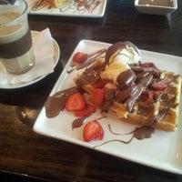 Photo taken at Theobroma Chocolate Lounge by Linda T. on 6/27/2012