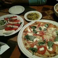 Photo taken at Carrabba's Italian Grill by D C. on 3/8/2012