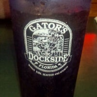 Photo taken at Gator's Dockside by Amy L. on 5/13/2011