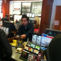 Photo taken at Starbucks by Ultra O. on 3/12/2012