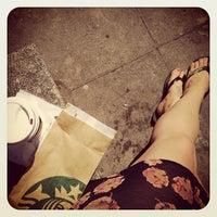 Photo taken at Starbucks by Sally R. on 5/27/2012