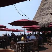 Photo taken at Sharky's Beachfront Restaurant by Cyrus K. on 6/30/2012
