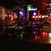 Photo taken at Coach's Bar & Grill by Merkin M. on 7/13/2012