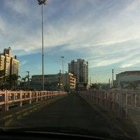 Photo taken at Ponte Giuseppe Garibaldi (Ponte Tramandaí - Imbé) by Eduardo F. on 3/22/2012