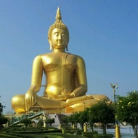 Photo taken at Wat Muang by Boyd T. on 8/2/2012