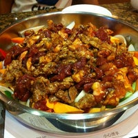 Photo taken at 黄记煌三汁焖锅 Hj.h Three-sauce Simmer Pot Rest. by Garry on 8/23/2012