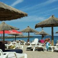 Photo taken at Plaja Neptun by Anusca B. on 8/14/2012