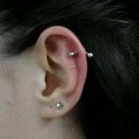 Photo taken at Simple Tattoo Piercing by Leandro R. on 4/21/2012